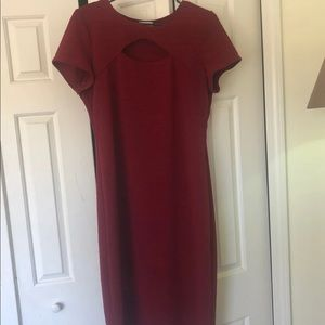 Maroon body con dress with cleavage peephole